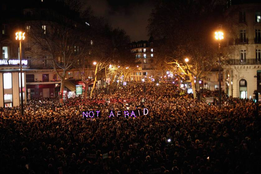 "People gather to pay respect for the victims of a terror attack against a satirical newspaper, in Paris, in Paris, Wednesday, Jan. 7, 2015. Masked gunmen shouting ""Allahu akbar!"" stormed the Paris offices of a satirical newspaper Wednesday, killing 12 people, including the paper's editor, before escaping in a getaway car. It was France's deadliest terror attack in living memory. (AP Photo/Thibault Camus)"